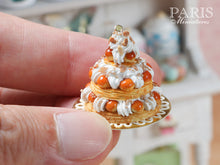 Load image into Gallery viewer, Triple Tiered St Honoré Pastry Centerpiece - Miniature Food in a hand to show 12th scale