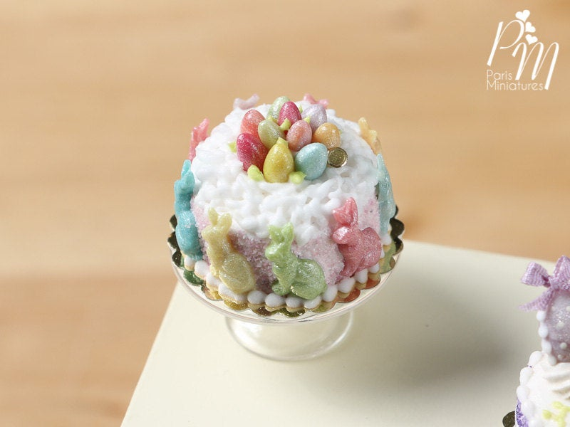Miniature Easter Cake Decorated with Colourful Bunnies and Eggs in White Cream Nest
