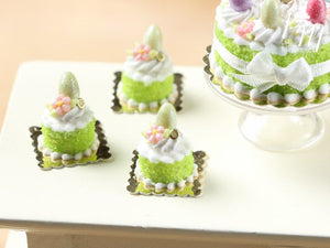 Spring Green Genoise Easter Individual Pastry Decorated with Candy Egg and Blossom