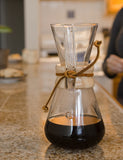 Angled shot of a Chemex Coffeemaker 3 Cup with freshly brewed coffee.
