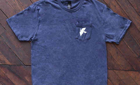Top view of a Dove Pocket T-Shirt.