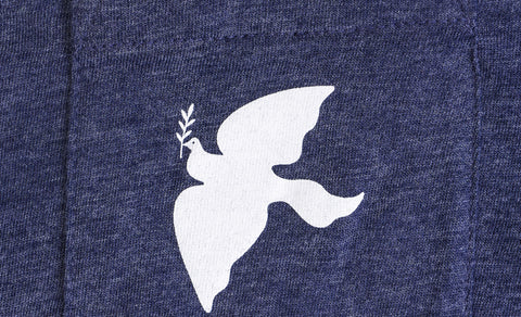 Close-up shot of the dove pocket on the t-shirt.