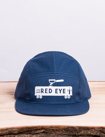 Front shot of a Red Eye - 5 Panel Hat.