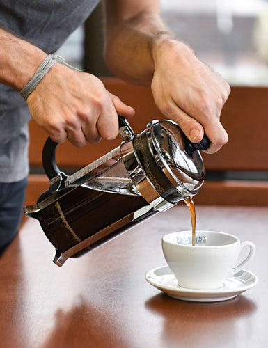 Image of someone pouring freshly brewed coffee from a Bodum Chambord French Press.