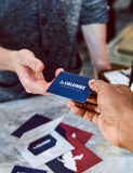 Image of someone giving a La Colombe Gift Card to someone else.