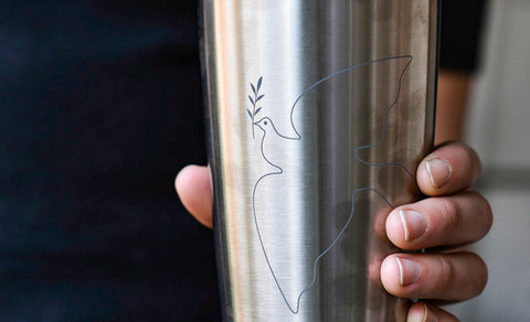 Close-up shot of someone holding a Miir To-Go Tumbler.