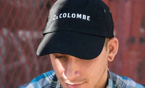 Image of someone wearing a La Colombe Baseball Cap.