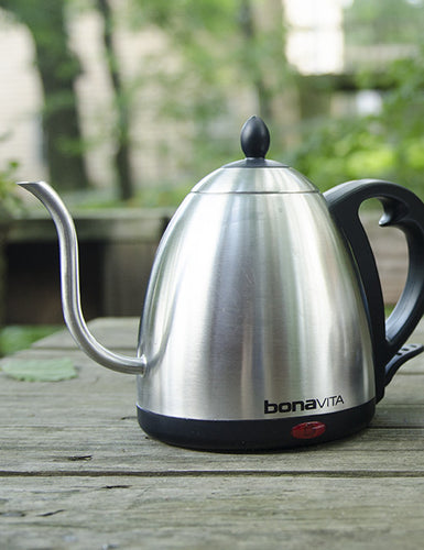 Another front shot of a Bonavita Electric Kettle outside.