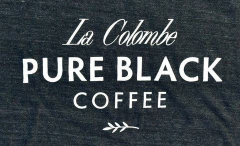 Close-up of the La Colombe logo on the Pure Black T-Shirt.
