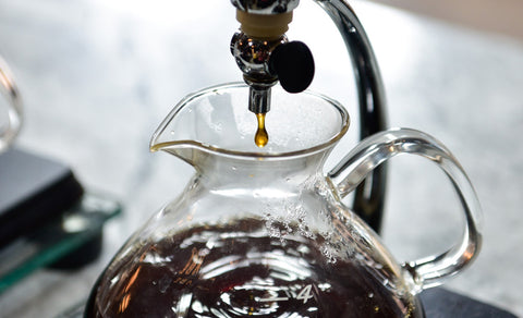 Angled close-up of a Yama Silverton in the process of brewing coffee.