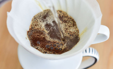 Top view of a Hario V60 in the process of brewing coffee.