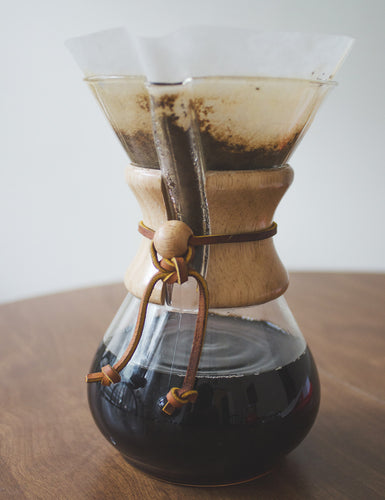 Angled shot of a Chemex Coffeemaker 6 Cup in the process of brewing coffee.