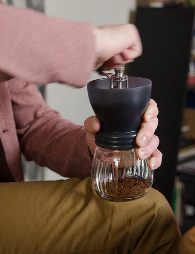 Image of someone using a Hario Skerton Plus Coffee Mill.