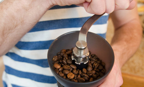 Angled view of the Hario Skerton Plus Coffee Mill with beans in the process of being ground.