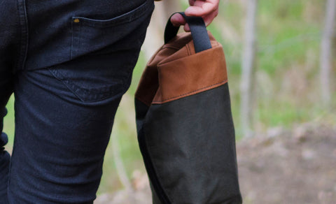 Image of someone carrying the Coffee Survivor Kit on a hiking path.