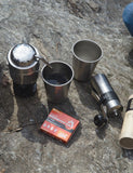 Top view of a Coffee Survivor Kit being used outside.