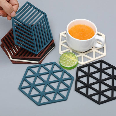 Creative Hollow Triangle Silicone Antiperm Pad Heat insulation Coasters Table Mat
