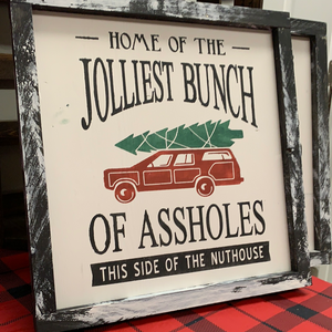 Home of the Jolliest Bunch Sign
