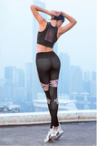 Women-wears-crane-design-sports-bra-and-leggings-on-landscape