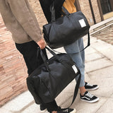 men-and-women-carry-black-leather-gym-bag