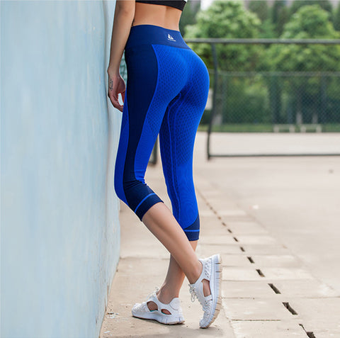 woman-wears-light-blue-capri-pants