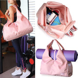 woman-carries-shoulder-gym-bag-with-large-space-and-yoga-mat