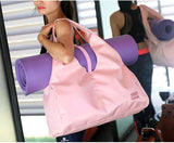 girl-carries-pink-waterproof-gym-bag-with-yoga-mat