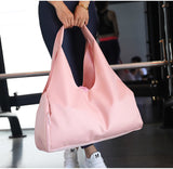 girl-holds-her-pink-waterproof-gym-bag