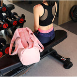 girl-with-pink-bag-sitting-on-the-bench-in-the-gym