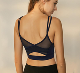 woman-wears-navy-blue-mesh-sports-bra-back