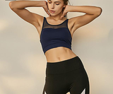woman-wears-navy-blue-sports-bra