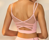 woman-wears-pink-mesh-sports-bra