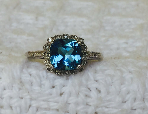 Sterling Silver Created Topaz & Genuine Diamond Ring