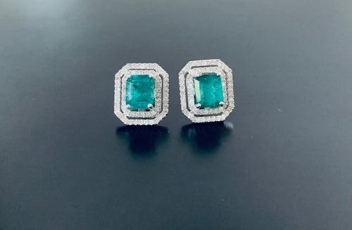 Stunning women's emerald and diamond earrings