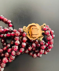 Three stranded Beaded Garnet and yellow gold Bracelet