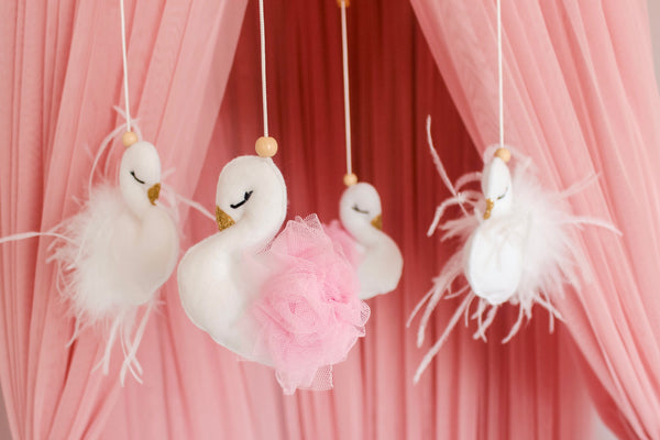 Pink and white swan mobile