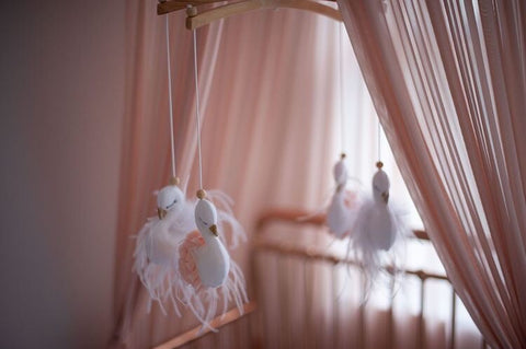 Blush pink and white swan mobile