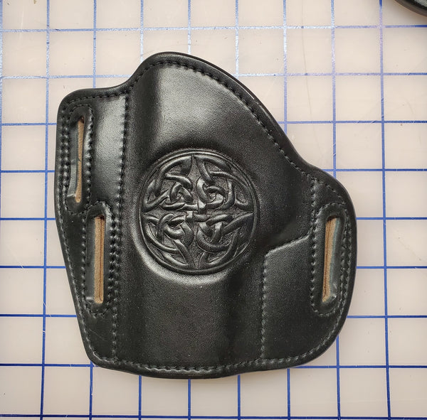 Black pancake holster with Celtic Shield tooling