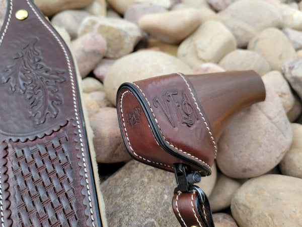 Handtooled and stitched buttstock cuff for Henry Axe stock with attached tooled sling