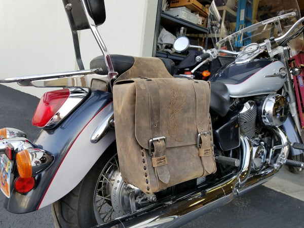 Custom Leather - custom motorcycle bags in oilskin and burned with a viking style dragon
