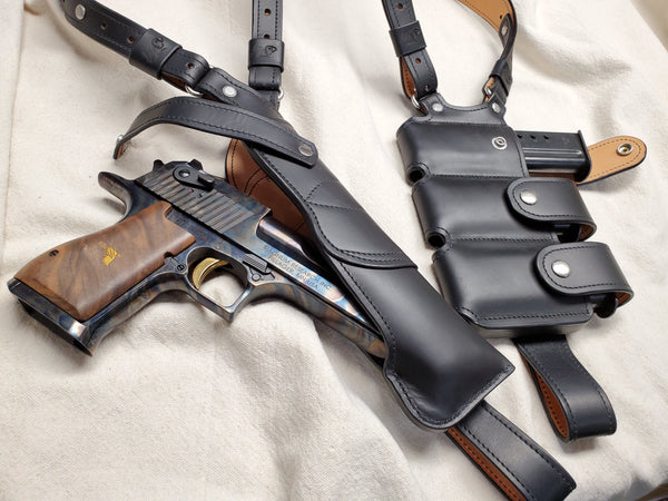 Black leather shoulder holster with three magazine pouches fit to a Desert Eagle