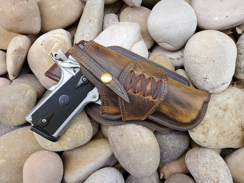Handcrafted western holster for 1911 in rustic distressed brown leather and criss cross lacing
