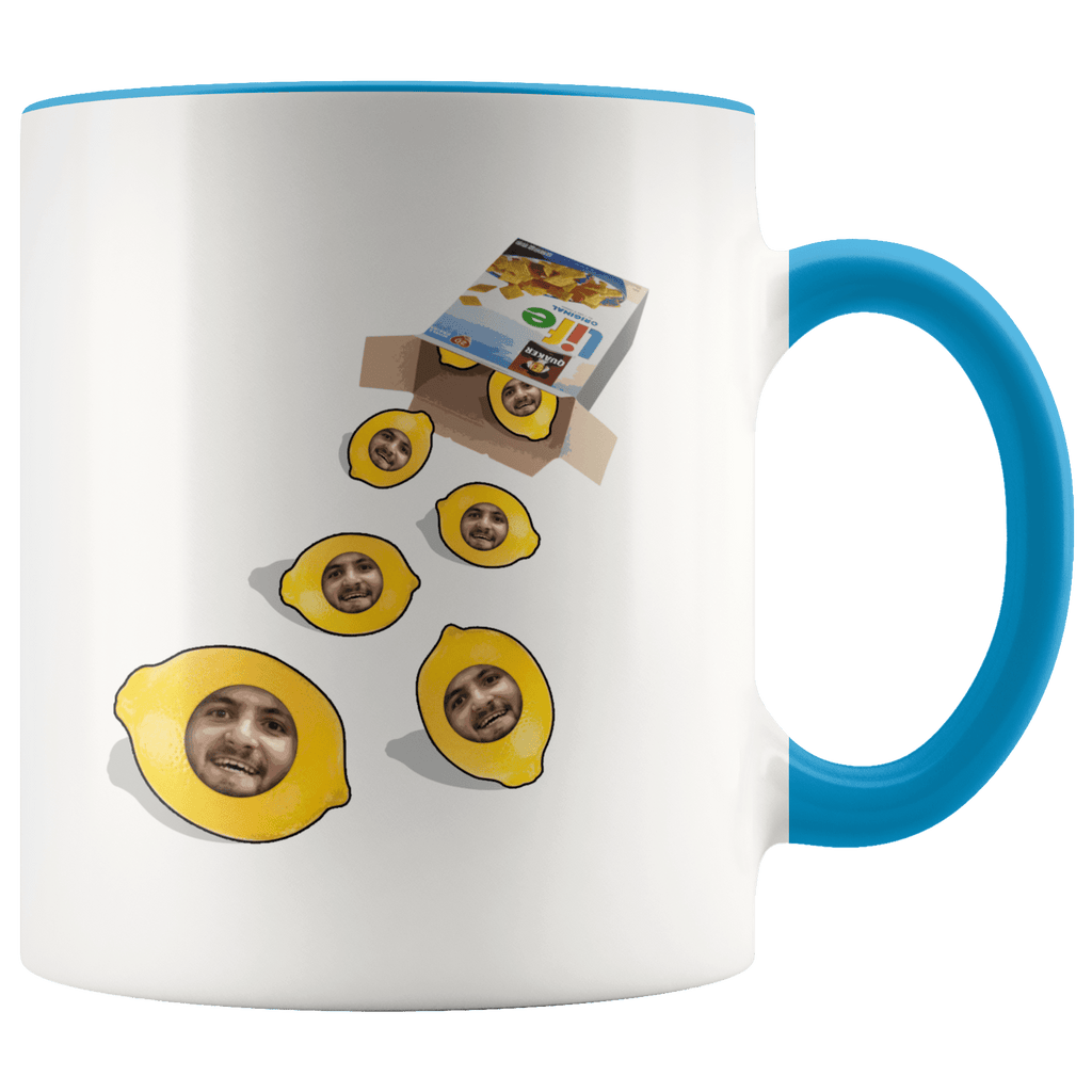 A coffee mug with a box of life cereal tipped over, with lemons rolling out of it with a mans face on each of them.
