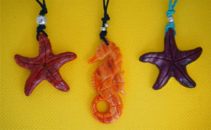 big red tumi pendant on leather - hand carved spondylus shell - Peru