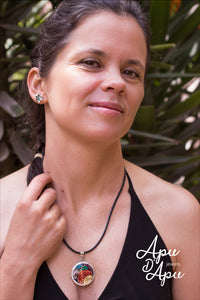 wearing large pachamama pendant necklace from Peru