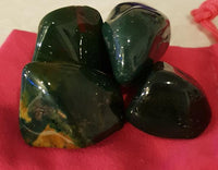 "The classic Bloodstone crystal is green jasper with red inclusions of Hematite.the inclusions resemble spots of blood, hence the name""bloodstone"""