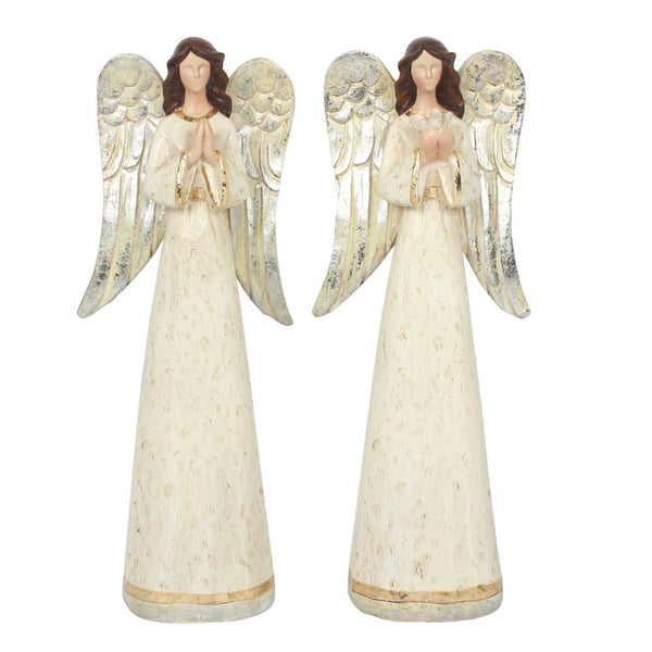 A set of two intricate free standing angel figurines in cream with a hit of silver finish. Lovely quality item. Each angel has their hands in a different position. One angel holds a dove and the other holds hands in a prayer position.