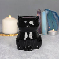 Lovely black cat oil burner which would make a fantastic gift for anyone with a love for cats. When not in use, this item also looks fantastic as an ornament in the home. This item can also be used as a wax melt burner however it is advisable to consider the size and depth of the bowl when adding wax to ensure it will not overrun the edges when melted.