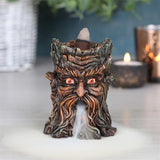An intricate backflow incense burner in a Green Man design. When the cone is lit the smoke from the cone cascades downwards in a mesmerising waterfall effect to pool at the bottom. Beautiful to watch.  H:8cm W:6.5cm D:6.5cm