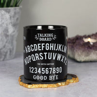 This quality ceramic mug features a classic talking board / ouija board design in white on a black base.The letters of the alphabet are positioned in a semi circle design with the words YES and NO at the top and numbers plus GOODBYE at the bottom. Dishwasher and microwave safe, this unique mug makes the perfect gift for those with an interest in the occult.
